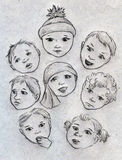 Baby faces. Eight faces of baby boys and girls with different facial expressions varying from sadness to happiness Stock Images