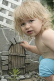 Baby and fairy door Stock Images