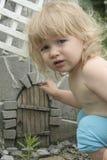 Baby and fairy door Stock Images