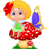 Baby fairy elf sitting on mushroom Royalty Free Stock Photography