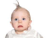 Baby with fake mohawk and a frown royalty free stock images