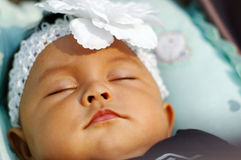 Baby fall asleep on her bed Stock Photography