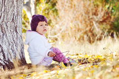 Baby in fall time Stock Photo