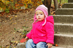 Baby in fall Royalty Free Stock Photo