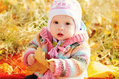 Baby in fall time Royalty Free Stock Photos