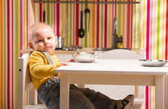 Baby family boy sit on toy kitchen Stock Photos
