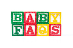 Baby FAQS - Alphabet Baby Blocks on white Royalty Free Stock Photo