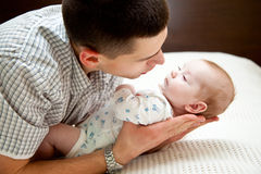 Baby and father Royalty Free Stock Image