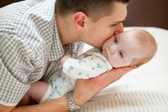 Baby and father Royalty Free Stock Photos