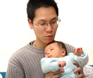 Baby and father. Photo of baby and his father Stock Images