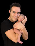 Baby and father bonding. Isolated proud father holding his 1 week old son in his arms stock photo