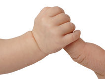 Baby and Father close-up. Hand of new born baby holding father's finger on white background with clipping path Royalty Free Stock Image