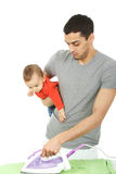 Baby and Father - Housework Royalty Free Stock Photos