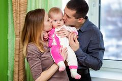 Baby, father and mother Stock Images