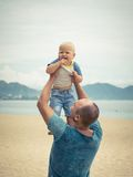 Baby and father Royalty Free Stock Images