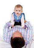 Baby on father's belly Stock Image
