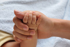 Baby and father's hands Royalty Free Stock Photos