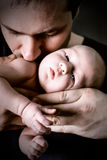 Baby on father's hands Stock Image