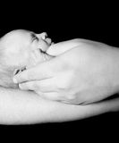 Baby in father's hands Royalty Free Stock Images