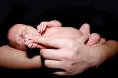 Baby on father's hands Royalty Free Stock Photo