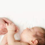 Baby and father's hands Stock Images