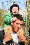 Baby on father's shoulders. On walk Stock Photo