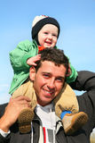 Baby on father's shoulders. On walk royalty free stock photo