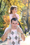 Baby on father`s shoulders Stock Images