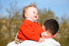 Baby on father shoulder Royalty Free Stock Photos