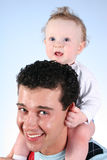 Baby on fathers shoulders. 2 royalty free stock photography