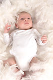 Baby in feathers Royalty Free Stock Photo