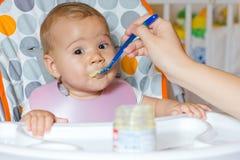 Baby feeding Stock Image
