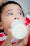 Baby feeding. Asia baby look and feeding bottle milk' Thailand Royalty Free Stock Photography