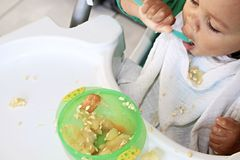 Baby feeding Stock Photo