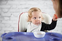 Baby feeding father Stock Photography