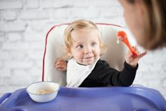 Baby feeding father stock photos