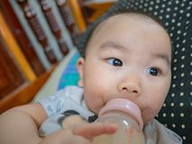 baby feeding milk stock image