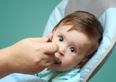 Baby feeding by mother Stock Images