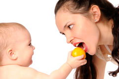 Baby feeding mother Stock Photos