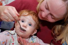 Baby Feeding with spoon Stock Photography