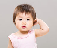 Baby feeling confused Stock Photography