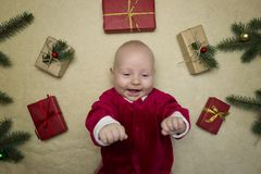 Baby feeling happy surrounded by christmas gifts stock images