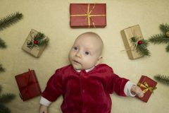 Baby feeling happy surrounded by christmas gifts stock photo