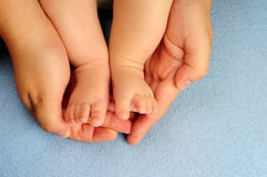 Baby feet in dads hand Royalty Free Stock Image
