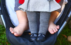 Baby feet with doll close up photo Stock Images