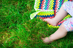 Baby feet in grass in summer Royalty Free Stock Photography