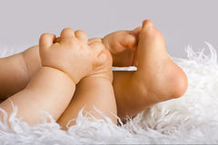 Baby feet and hands Royalty Free Stock Photography