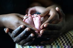 Baby feet in hands