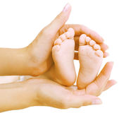Baby feet in hands mother. Closeup Royalty Free Stock Images