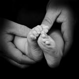 Baby feet isolated on black Stock Photography